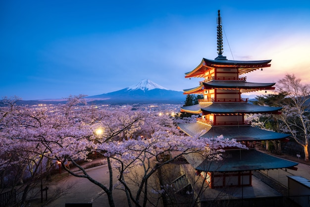 Japan at chureito pagoda and mt. fuji in the spring with cherry blossoms full bloom during twilight. Premium Photo