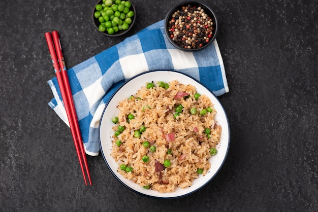 Japan fired rice with peas and chopstick Premium Photo