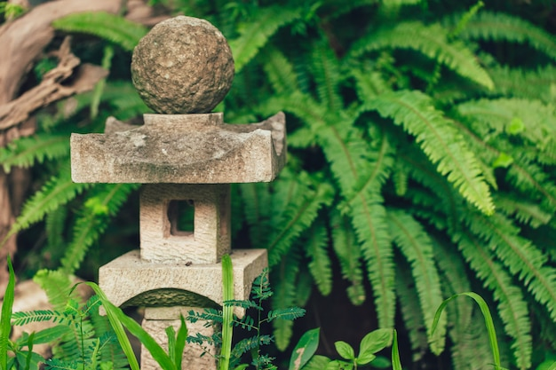 Japan style stone lantern lamp in japanese garden Premium Photo