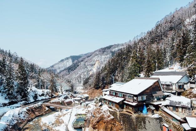 Japan village among snow and mountain Free Photo