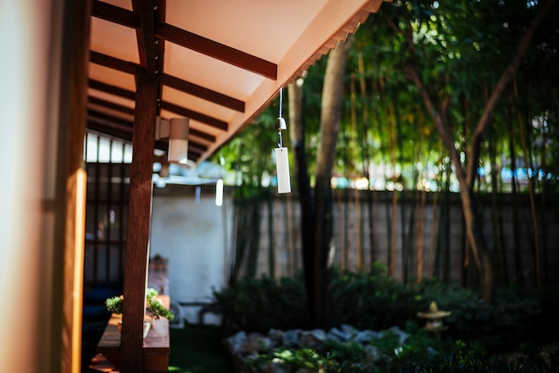 Japanese bell hanging on roof with sunshine at the japan garden. Premium Photo