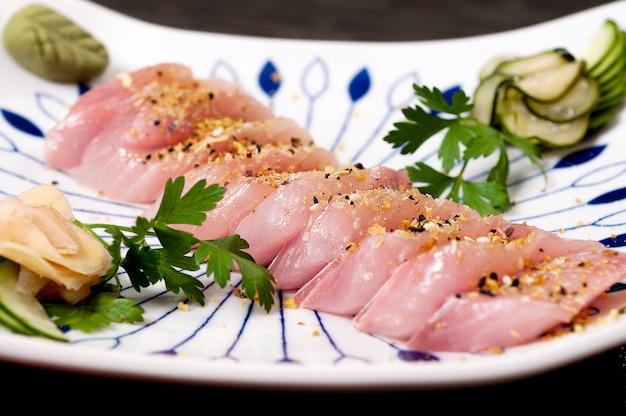 Japanese food fish sashimi and veggies dish meal, asian fresh food, sea food Premium Photo