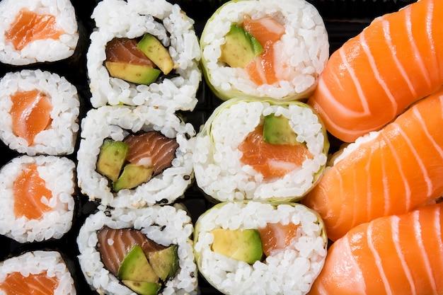 Japanese food: maki and nigiri sushi set on black. close up Premium Photo