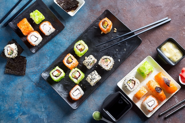 Japanese food- sushi, rolls, chopsticks, soy sauce on ...