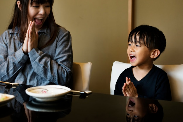 Japanese mother and son praying Free Photo