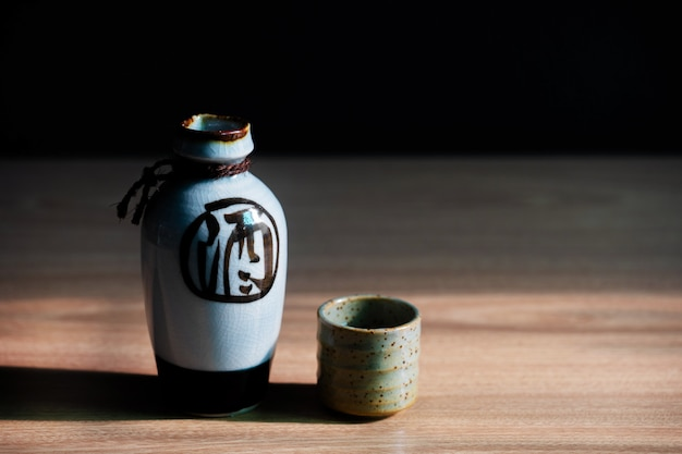 Japanese sake oriental drink style on the table Premium Photo