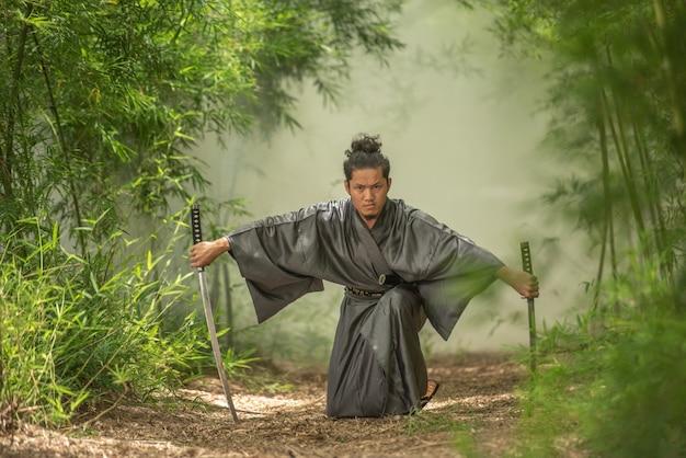 Japanese samurai fighter wearing traditional uniform Premium Photo