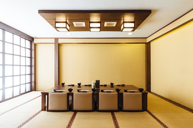 Japanese Style Dining Room With Wooden Table In The Center ...