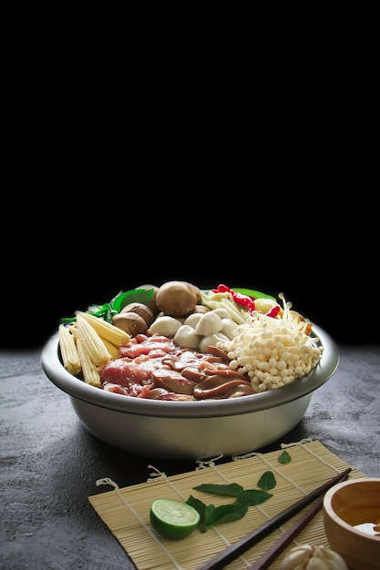 Japanese sukiyaki in traditional cast iron pot. chabu sukiyaki, japanese food. Premium Photo