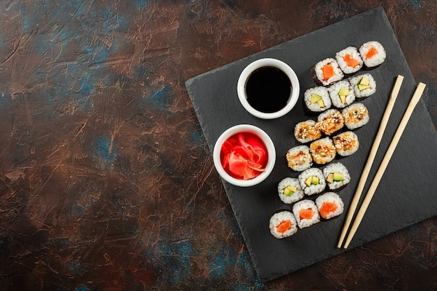 Japanese sushi on a rustic dark background. Premium Photo