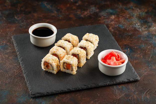 Japanese sushi on a rustic dark background. Premium Photo