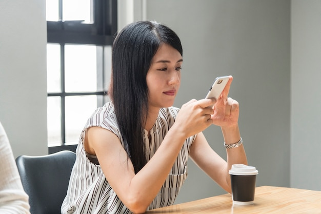 Free Photo   Japanese woman playing on her phone