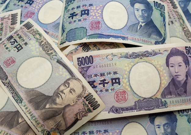 Japanese yen notes and japanese yen coins for money concept background Premium Photo