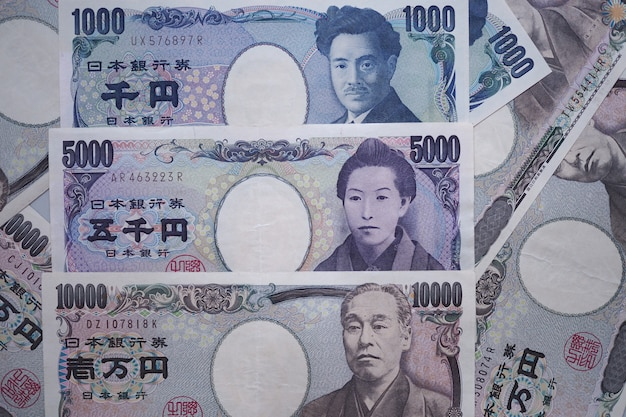 Japanese yen notes and japanese yen coins for money concept Premium Photo