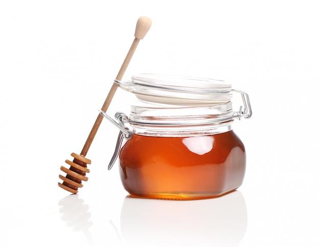 Jar with fresh honey Free Photo
