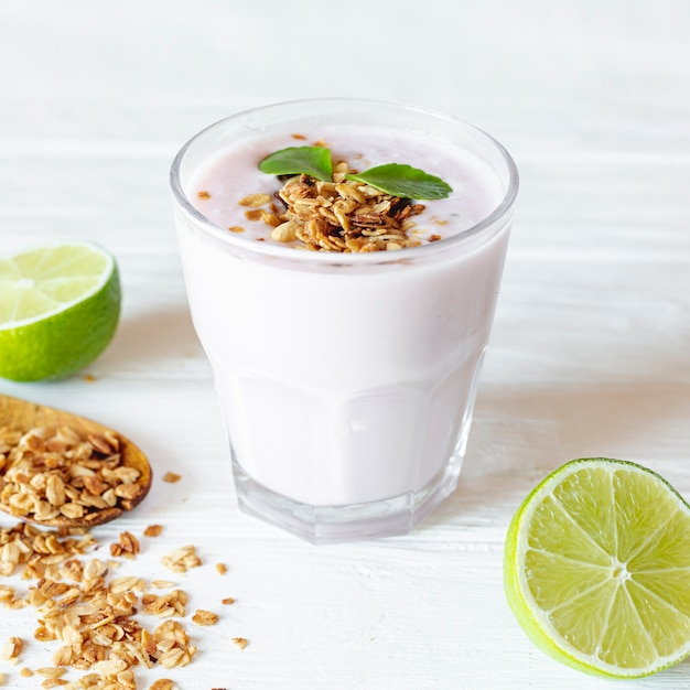 Jar of yogurt and half cutted lime Free Photo