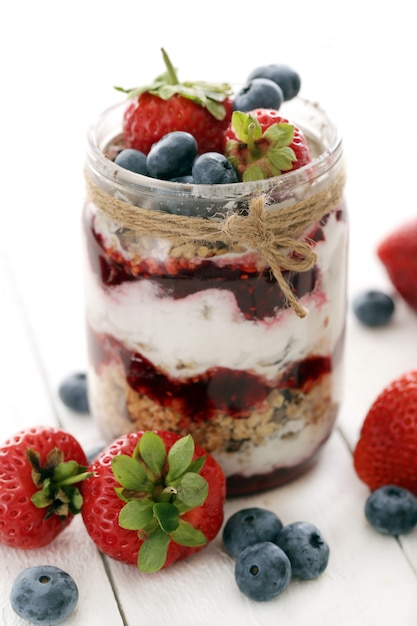 Jars with berries Free Photo