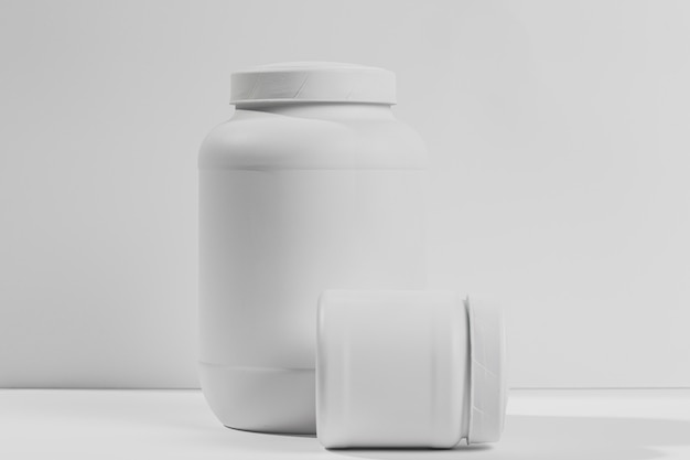 Jars with gym supplements Free Photo