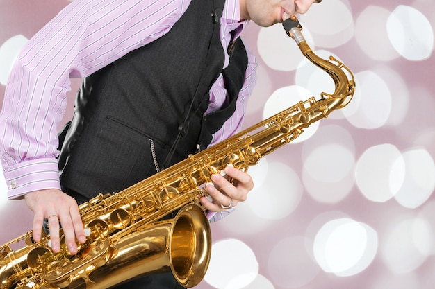 Jazz saxophone player in performance on the stage. Premium Photo