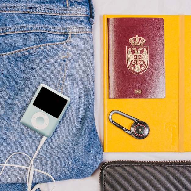 Jeans, mp3 player and passport Free Photo