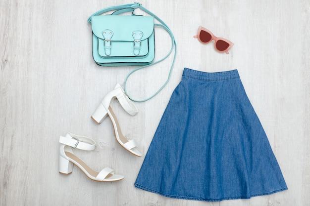Jeans skirt, glasses, white shoes and handbag Premium Photo