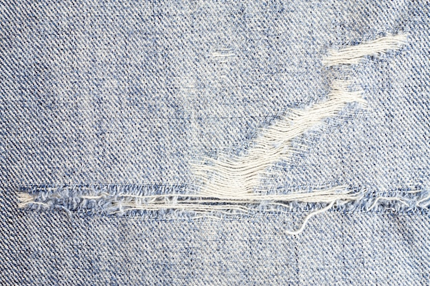 Jeans torn background, denim texture. Premium Photo
