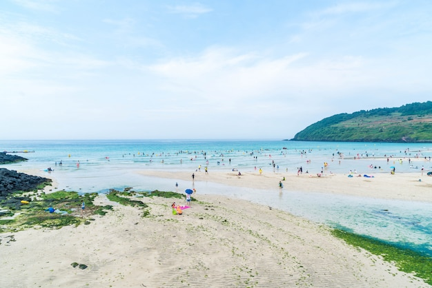 Jeju, korea - july 9, 2017: tourist enjoied in the sea at hamdeok beach Premium Photo