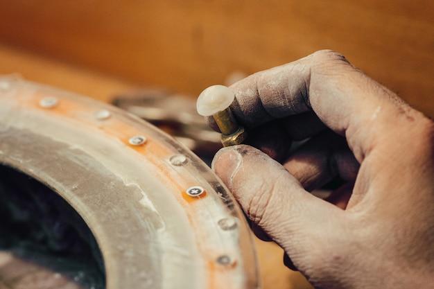 Jeweller polishing a stone blue cubic zirconia Premium Photo