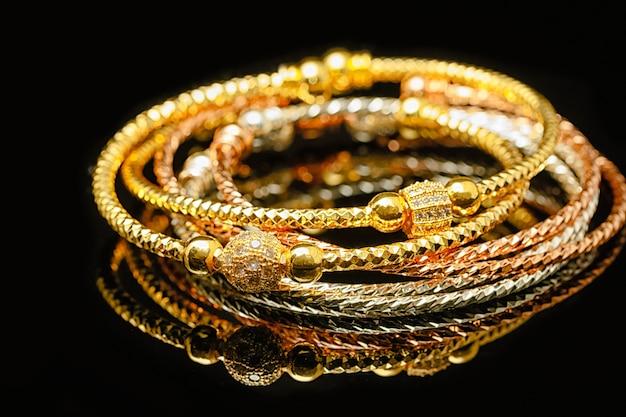 Jewelry and bracelets on black background Premium Photo