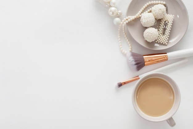 Jewelry for the bride, sweets and coffee, on a white background. concept weddings, preparation and morning of the bride. Premium Photo