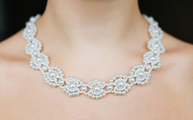 Jewelry concept. closeup portrait of a wedding necklace on female neck Free Photo
