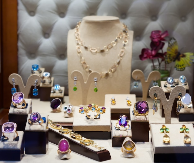 Jewelry with gems at showcase Free Photo