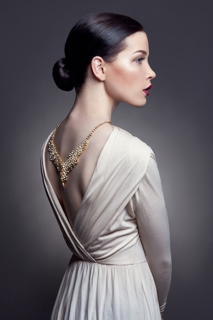 Jewels on the girl's neck beautiful gold necklace Premium Photo