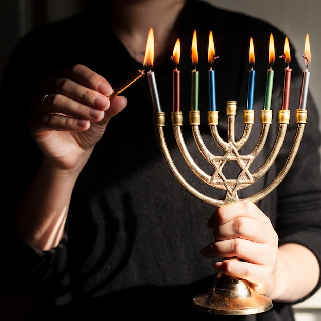 Jewish candlestick holder with candles Free Photo