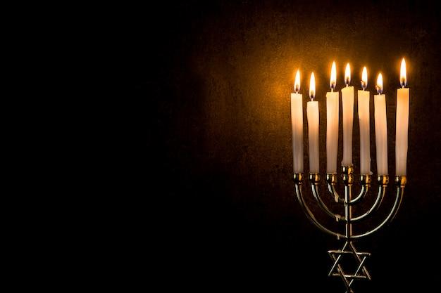 Jewish hanukkah menorah on black copy space Premium Photo