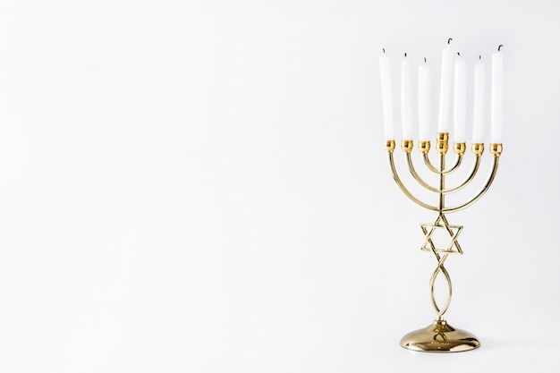 Jewish hanukkah menorah on white surface Premium Photo