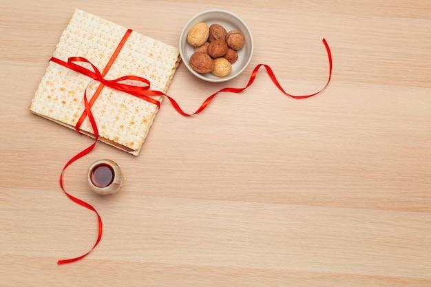 Jewish holiday passover banner design with wine Premium Photo