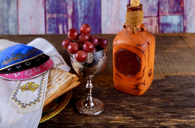 Jewish holiday passover matzot and tallit the substitute for bread on the jewish passover holiday. Premium Photo