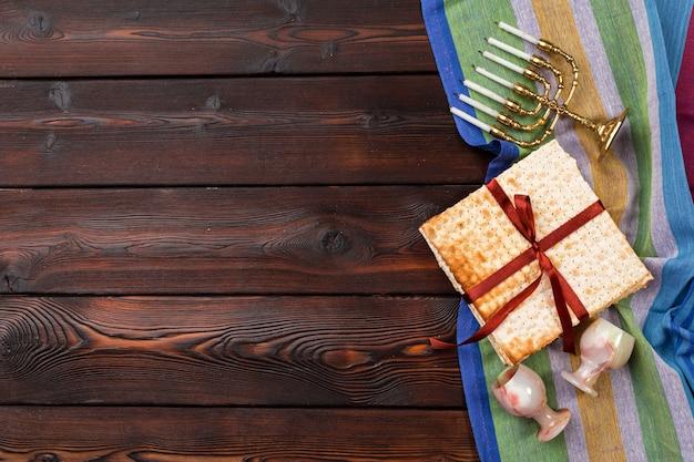 Jewish holiday passover with wine, matzo on wooden. Premium Photo