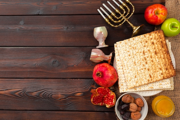 Jewish holiday passover with wine, matzo on wooden. Premium Photo