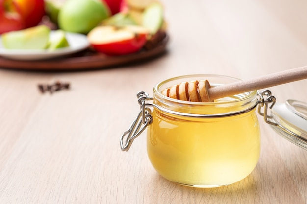 Jewish holiday rosh hashanah  with honey and apples on wooden table, Premium Photo