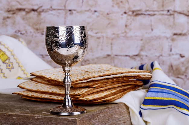 Jewish holidays passover pesach matzah and a silver cup full of wine Premium Photo
