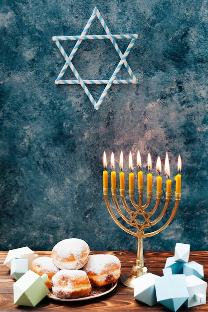 Jewish sweets with candleholder on a table Free Photo