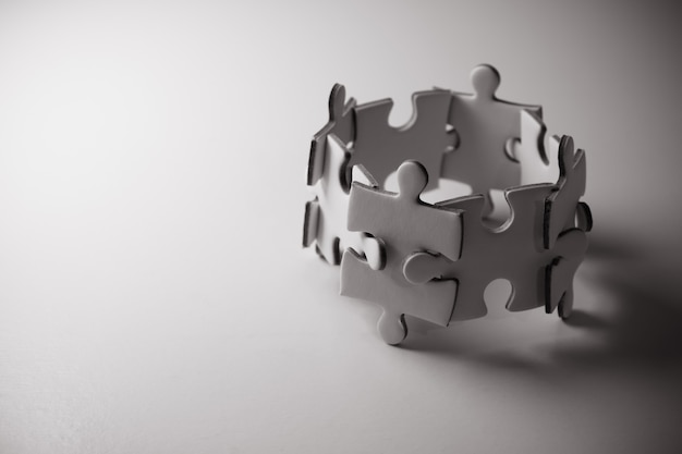 Jigsaw puzzle concept teamwork. team building help and support concept. Premium Photo