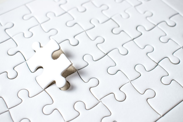 A jigsaw puzzle of the missing success teamwork. Premium Photo
