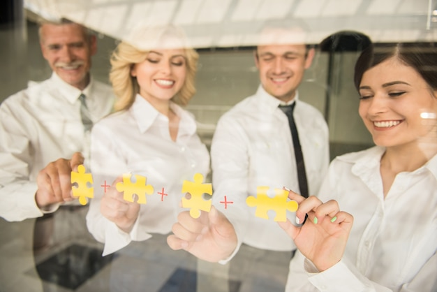 Jigsaw puzzle and represent team support and help concept. Premium Photo
