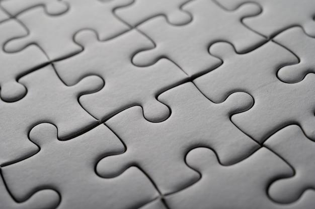 Jigsaw puzzle white colour,puzzle pieces grid,success. Free Photo