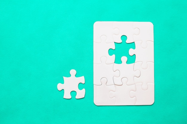 Jigsaw puzzle with missing piece on mint background Premium Photo