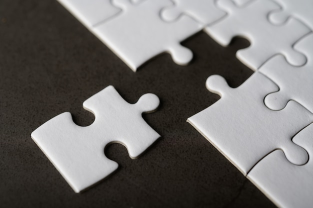 Jigsaw puzzle with missing piece. missing puzzle pieces Free Photo