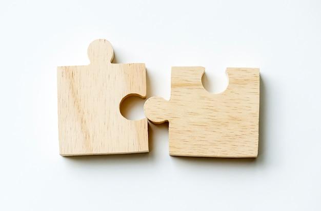 Jigsaw teamwork concept macro shot Free Photo